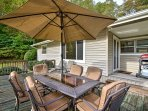 Have a barbecue at the outdoor table with seating for 6, an umbrella, and a gas grill.