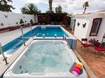 Enjoy the outdoor pool area. Lots of different seating and sunbathing areas available.