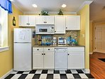 The kitchen is well equipped with updated appliances to create a home-cooked meal.