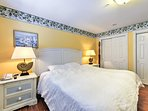The master bedroom features a plush king bed to retreat to at the end of the day.