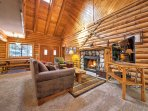 Step inside and enter the open-concept living space with high vaulted ceilings.