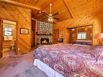 The master bedroom boasts a comfortable king bed, wood-burning fireplace and a pristine en-suite bathroom.