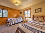 This room provides a full bed and twin bed.