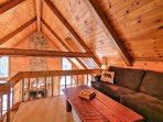You're sure to love the exposed beam cathedral ceilings!