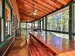 The 9-foot table on the screened-in porch allows for outside dining - away from the pests!