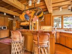 Inside, the 3,000-square-foot home is beautifully appointed with wood accents, flagstone floors, and large windows.