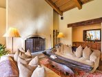 Settle down on one of the plush couches next to the wood-burning fireplace in the living area.