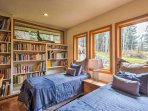 The third bedroom offers 2 twin-sized beds in a library setting.