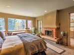 Fall asleep easily as the wood-burning fireplace warms the master suite.