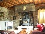 Lounge Area  with TV &wood burning stove