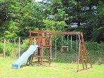 Climbing frame, slide and swings