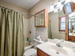 Freshen up in this full bathroom that offers a shower/tub combo.
