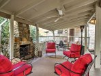 Spend cool evenings around this beautiful stone hearth at this vacation rental house in Newland!