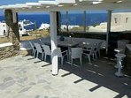 Outdoor pergola seats with bar. Seats 14+ persons.
