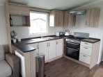 Fully equipped kitchen with microwave, gas oven, kettle, toaster, crockery, utensils, pans & cutlery