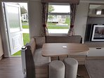 Dining area seats 6 comfortably. A high chair is available by prior arrangement