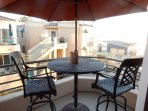Private balcony with table, chairs, umbrella and Charcoal Grill