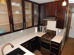 Great cabinets and fixtures in kitchen