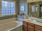 This en-suite bathroom offers a Jacuzzi tub.