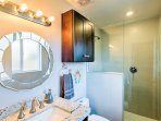 The master en-suite bathroom is equipped with a lavish walk-in shower and single vanity.