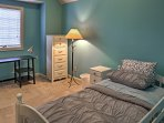 Cuddle up in this queen bed for a peaceful night of rest.