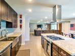 Create a home-cooked meal for the family in the fully equipped kitchen.