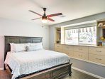 The master bedroom features a large king bed.