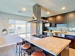 Cooking will be a breeze with stainless steel appliances, granite counters, and a large kitchen island to use.