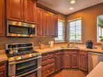 The kitchen boasts ample counter space and stainless steel appliances.
