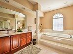 Enjoy a morning soak in the large tub.
