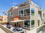 Home is one house off ocean, with large ocean view deck and expansive ocean views from multiple rooms