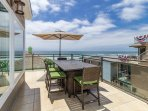 Spacious Balcony with Ocean View, large dining table and BBQ