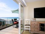 Enjoy partial ocean views from the couch in living room