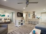 Lower unit: 1st level: Living room connects with pocket door to a room that can be used as bedroom or dining area...