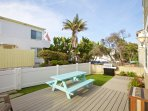 Large patio with BBQ and table, one house off the ocean