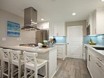 Lower unit: 1st level - Fully equipped gourmet kitchen with 4 bar stools