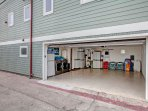 Garage with plenty of beach equipment and washer/dryer
