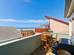 3rd level: Balcony off the kitchen, with BBQ and bar table/chairs, with ocean view