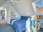 3rd floor King bedroom with crank open dormer windows with some water views