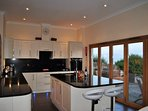 The modern kitchen is stylish and a great social space