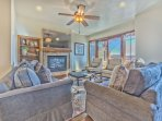 Main Level Living Room with Comfortable Modern Furnishings, Beautiful Hardwood Floors, Gas Fireplace, 65' HD Smart TV...
