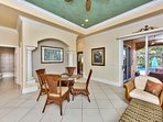 Dining Room Area With Seating For 4; Sliding Glass Door Leads to Pool;