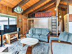 After an exciting day on the mountain, rest and relax in this open living area with a flat-screen Smart TV.