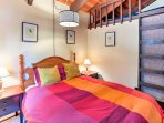 Additional guests can sleep cozily in the loft area.