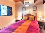 The second bedroom features a queen bed and storage for your belongings.