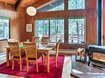 Relish family feasts at the 6-person dining table with incredible forest views.