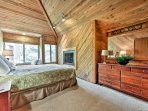 You'll love retreating to the master bedroom, which features a second gas fireplace.
