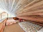 A loft offers 2 twin beds for additional sleeping arrangements.