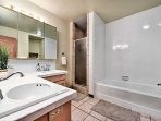 Freshen up in the master en-suite that features dual sinks and a shower/tub combo.
