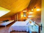Habitación 1 de 18 m² cama matrimonio y sofa cama